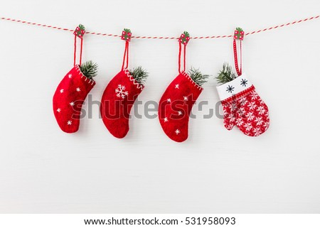 Red Christmas decoration on white wooden background. Copy space