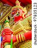 Red giant and golden dress, Thailand. - stock photo
