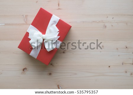 Red gift boxes on wooden floor concept for Happy new year and Christmas concept