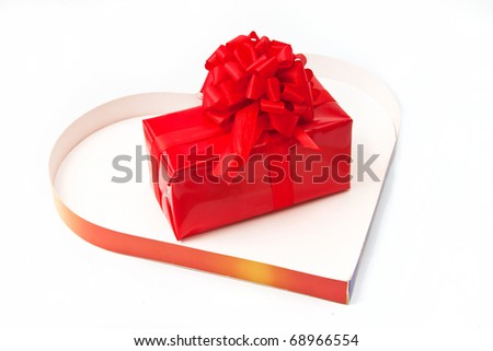 Red gift inside a heart box