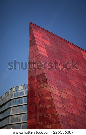 red glass building skyrocketing and showing new perspectives and greatness
