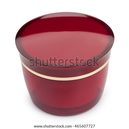 Red glossy round box container with cosmetic cream isolated on a white background.