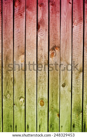 Red green toned boards texture abstract, planks flat surface, wood background in vertical orientation, nobody.