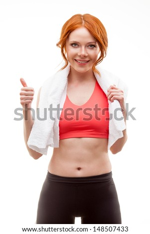 red-haired happy woman standing with towel over white