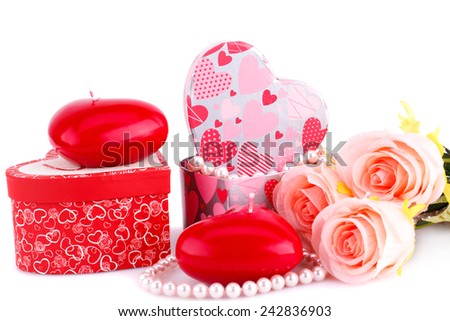Red heart candles, roses, necklace and gift boxes on white background.