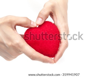 Red heart in hands white background isolated