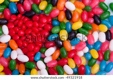 Red heart made of candy surrounded with jellybeans