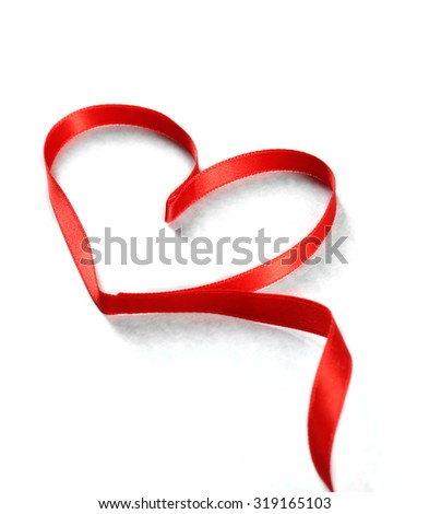 Red heart ribbon on light grey textured background