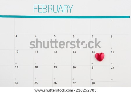 Red heart shape symbol on the February 14th date on a calendar for Valentine's Day