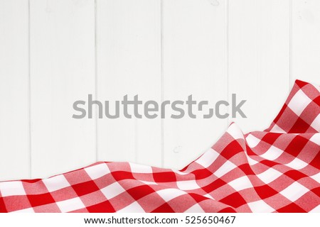 Red holiday tablecloth on the wooden white boards
