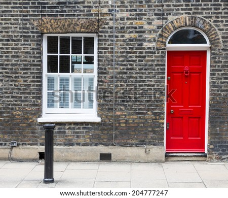 Red house door on a London street & Red House Door On London Street Stock Photo 204351505 - Shutterstock pezcame.com