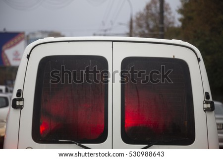 Red light into a car. Close up of a back car.