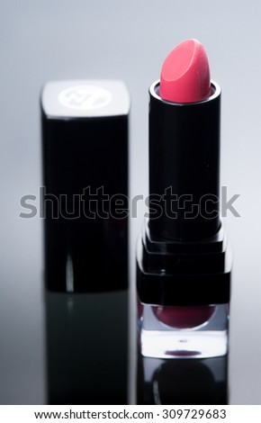 Red lipstick on reflected glass background
