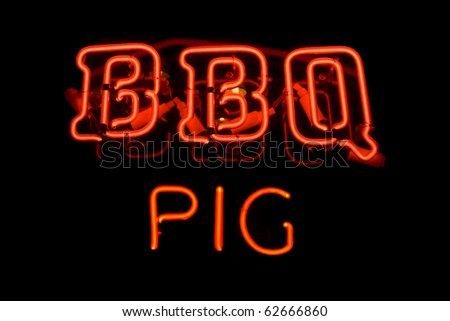 Red neon sign of the word 'BBQ Pig' on a black background.