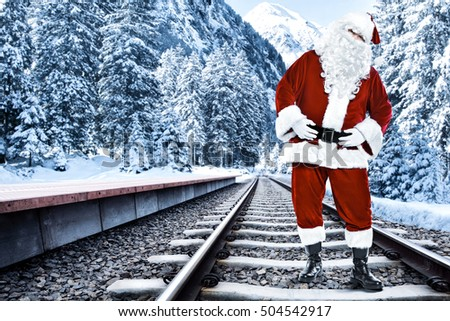 Red old santa claus and train station of winter time
