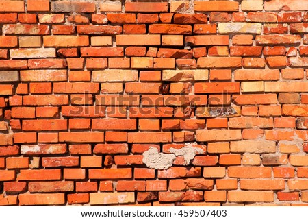 Red old worn brick wall texture background