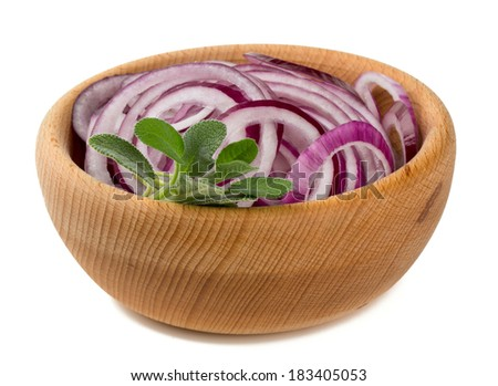 red onion slices in a wooden bowl isolated on white
