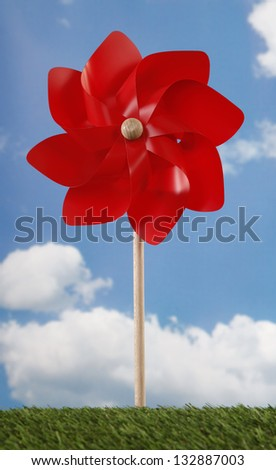 Red pinwheel toy and sky