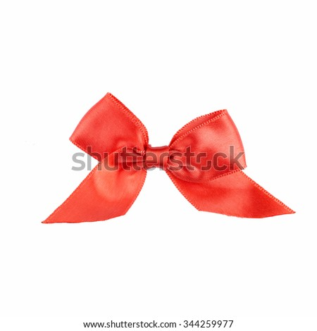 Red ribbon bow with tails isolated on white background