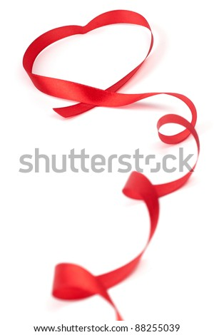 Red ribbon curled in heart shape isolated on white background