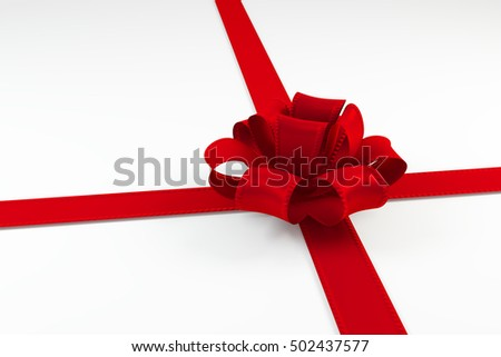 red ribbon tie in a bow isolated on white background. 3D rendering object.