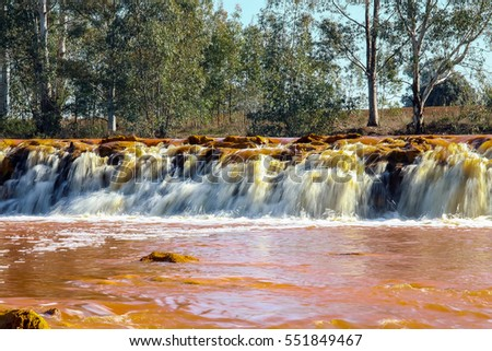 Red river waterfall. Red tinted river by copper on the ground. Water used in life study for life detection in Mars