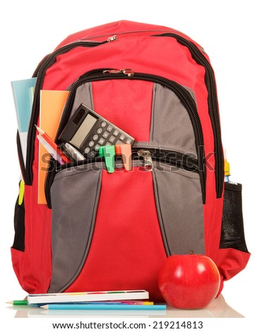Red school backpack with apple isolated on white