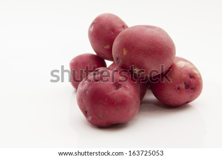 Red Skinned Potatoes on Bright Background