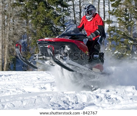 red snowmobile jumper