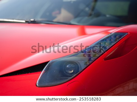 red sport car modern luxury close up detail
