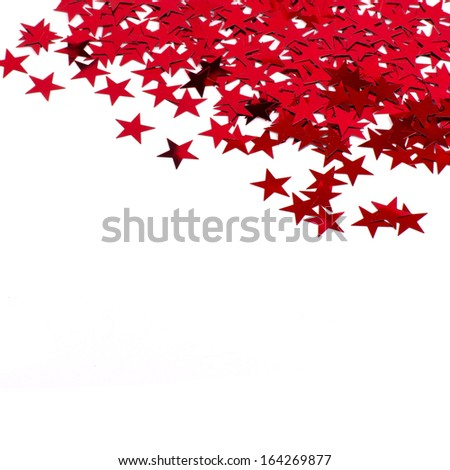 Red stars confetti isolated on white background