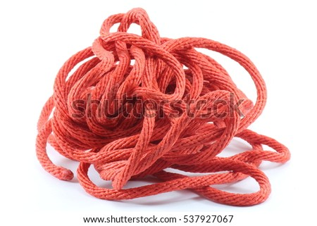 Red string knotted on a white background.