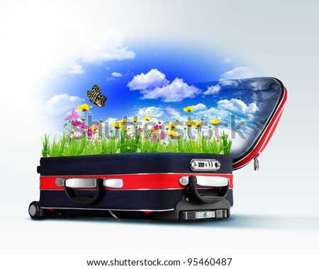 Red suitcase with green nature landscape in it