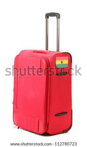 red suitcase with sticker with flag of Ghana isolated on white