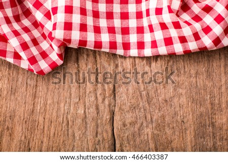 red tablecloth on wooden background