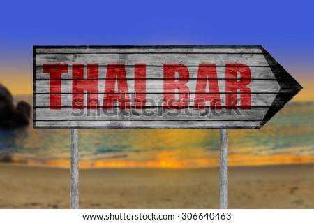 Red Thai Bar wooden sign with on a beach background