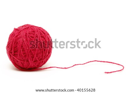 Red thread clew isolated over white background (macro shot)