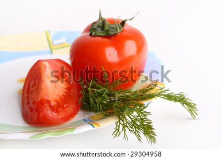 Red tomato with dill