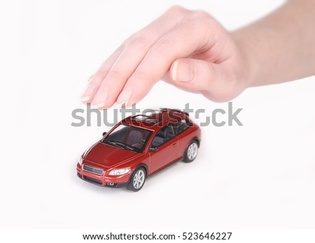 red toy car covered with female hand