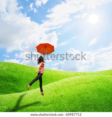 Red umbrella woman in grassland and sun sky