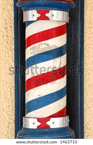 Red, white and blue barber pole on side of building