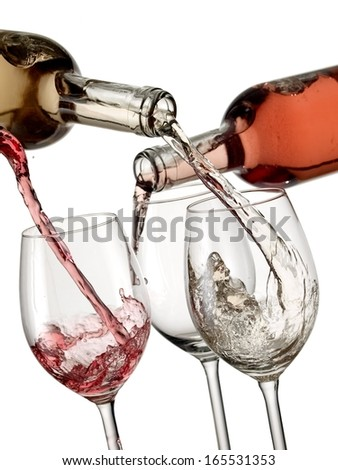 Red, white and rose wine start pouring in three glasses