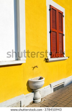 red window  varano borghi palaces italy   abstract  sunny day    wood venetian blind in the concrete  brick