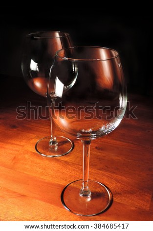 red wine glasses on a wooden table