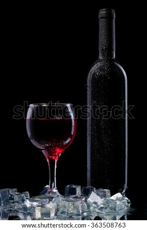 Red wine in bottle and wineglass