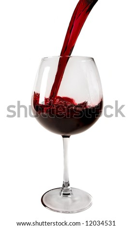 Red wine poured into the glass isolated on white