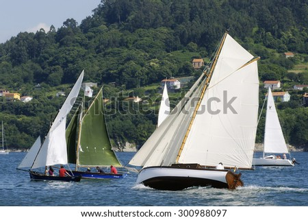 Redes Village, Galicia, Spain , July 21, 2012 . Traditional sailing  boats racing regatta in Ares bay