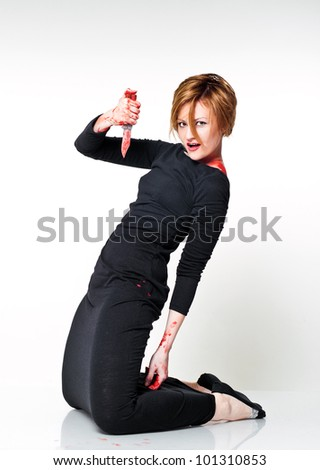 redhead woman with bloody knife in her hand