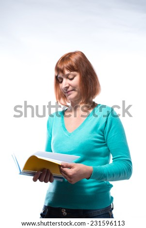 Redhead woman with book in hand