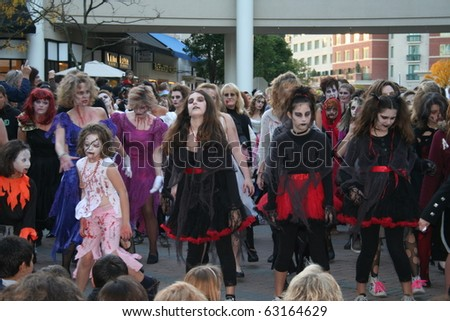 "REDMOND, WASHINGTON USA - OCT 25: unidentified Dancers dressed as zombies perform Oct 25 2009 in Redmond, Washington. Annually, dancers around the world perform a ""Thrill the World"" zombie dance."